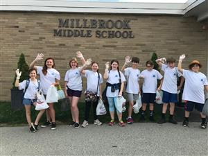 Photo of Wellness Club students in front of Millbrook Middle School