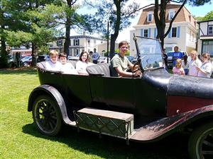 Photo of Students in Car at Millbrook Car Show